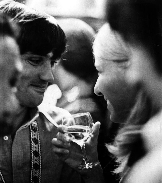George+Best+talking+to+his+girlfriend+Eva+Haraldsted+holding+a+glass+of+wine+at+a+social+event+in+1968