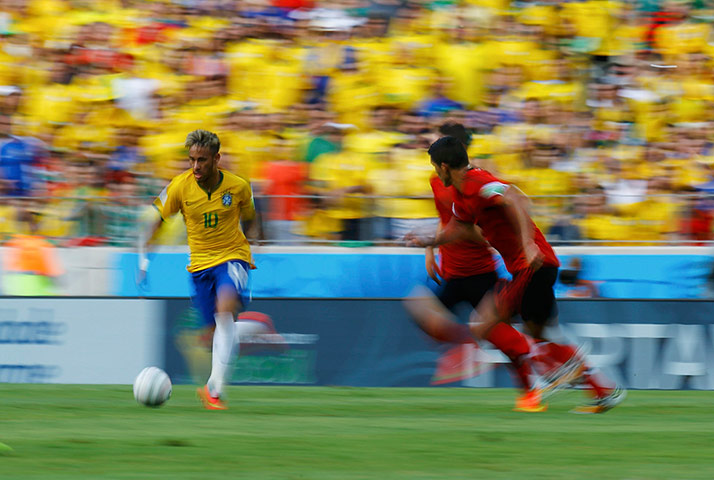 Brazil's Neymar controls the ball
